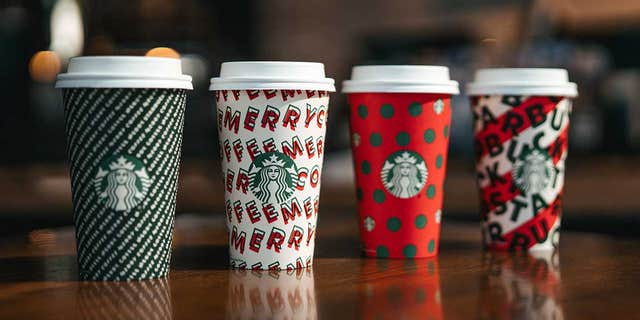 "Starbucks' new designs, seen here, include (L-R) ""Merry Stripes,"" ""Merry Dance,"" ""Polka Dots"" and ""Candy Cane Stripe."""