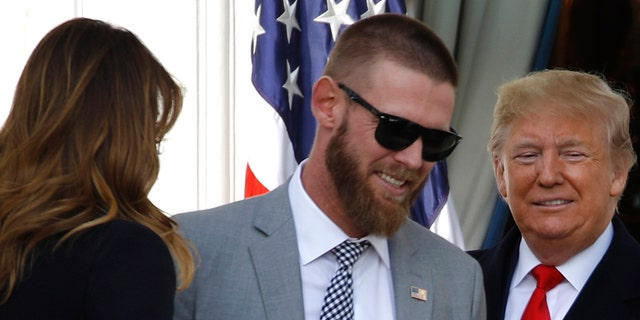 President Trump with Washington Nationals starting pitcher Stephen Strasburg at Monday's ceremony, with first lady Melania Trump nearby. (AP Photo/Patrick Semansky)