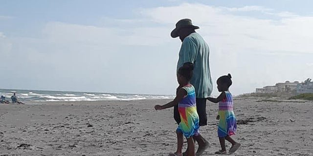 Stephone Ritchie Sr. plays with his children on Cocoa Beach before attempting to rescue his sons from a dangerous rip current.