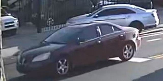 Police said the gunfire came from the backseat of a red or maroon Pontiac G6 (pictured here).