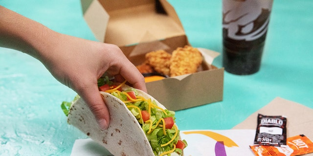 """Crispy Tortilla Chicken, a new menu item that the brand calls """"the ultimate Taco Bell variant"""" of a classic. White meat chicken dipped in a jalapeno buttermilk marinade before being breaded with a """"crispy tortilla chip coating"""". Available in strips or as a filling in a soft taco."""