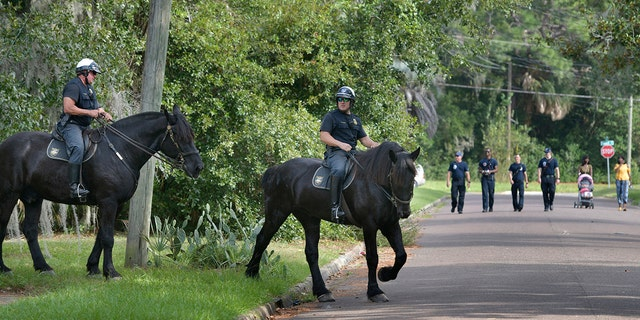Mounted police join firefighters in Jacksonville in the search for 5-year-old Taylor Rose Williams who went missing around midnight Wednesday, November 6, 2019 in Jacksonville, Florida.