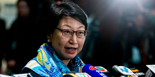 Hong Kong's justice secretary Teresa Cheng speaks to the media at the Legislative Council in Hong Kong on January 24, 2018, after answering lawmakers' questions about illegal structures found at some of the properties she owns. / AFP PHOTO / ISAAC LAWRENCE (Photo credit should read ISAAC LAWRENCE/AFP via Getty Images)