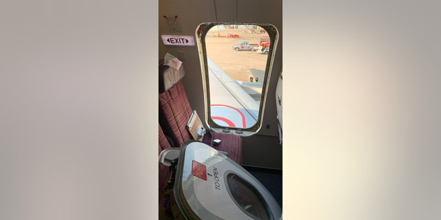 """A spokesperson for Thai Smile Airways has apologized after a """"crazed"""" passenger, who was reportedly drunk when he ripped an emergency exit door open just moments before takeoff."""
