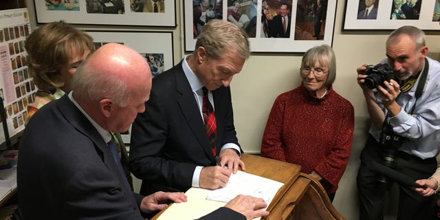 Tom Steyer files to place his name on New Hampshire's presidential primary ballot, at the Statehouse in Concord Tuesday.