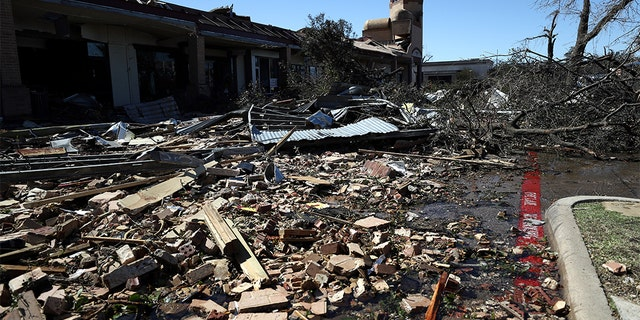 Debris litters the Preston Royal shopping area in Dallas Oct. 21. (Photo by Ronald Martinez/Getty Images)