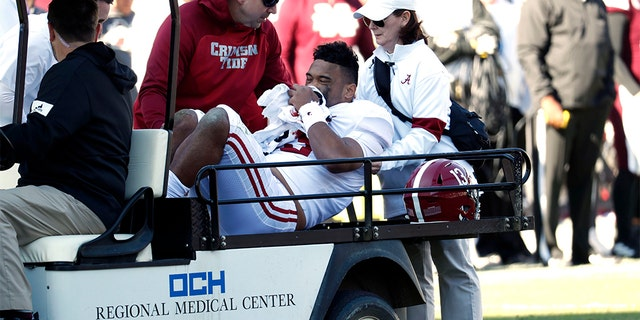 Tua Tagovailoa: Top NFL quarterback prospect carted off with hip injury