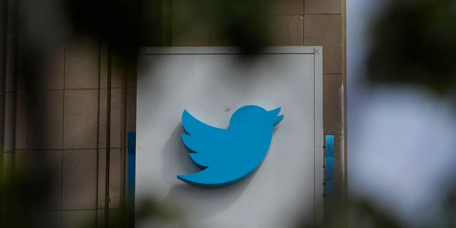 FILE - This July 9, 2019, file photo shows a sign outside of the Twitter office building in San Francisco. The Saudi government recruited two Twitter employees to get personal account information of their critics, prosecutors said Wednesday, Nov. 6, 2019. (AP Photo/Jeff Chiu, File)