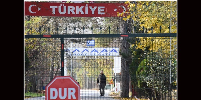 A man, allegedly a U.S. citizen and member of the Islamic State group, who was deported by Turkish officials and rejected by Greek police, standing in a no man's land at the border between Turkey and Greece near Pazarkule, is seen from the Turkish side in Edirne, on Nov. 11, 2019. (DHA/DHA/AFP via Getty Images)