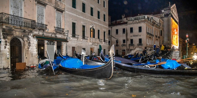 Stranded gondolas float adrift over the flooded banks, in Venice, Wednesday, Nov. 13, 2019.
