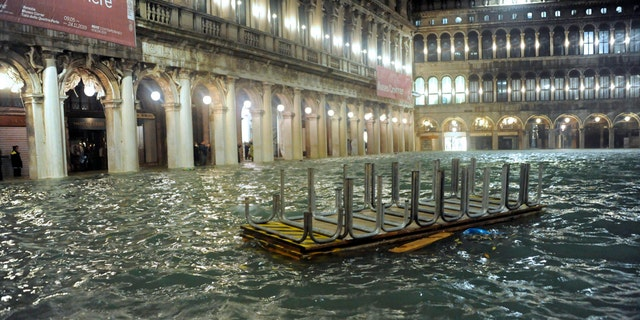 An overturned catwalk used as a walkway during high water floats in an over flooded St. Mark's Square late Tuesday, Nov. 12, 2019.