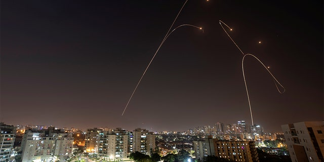 Israel's Iron Dome anti-missile system fires interception missiles, as seen from the city of Ashkelon Wednesday.