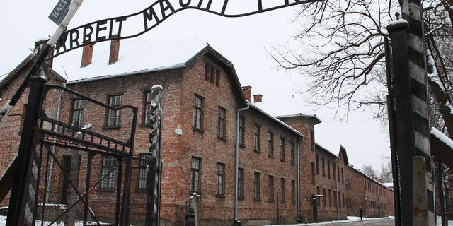 'Arbeit Macht Frei' sign at the former Nazi concentration camp Auschwitz in Oswiecim, Poland on 27 January 2015. (Photo by Jakub Porzycki/NurPhoto via Getty Images)