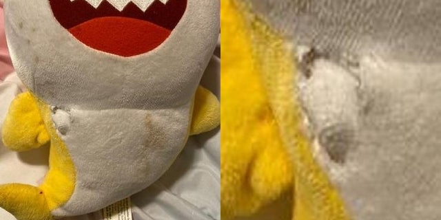"""Police say a bullet narrowly missed a toddler after it was absorbed by a """"Baby Shark"""" toy."""