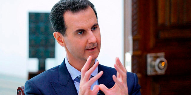 Syrian President Bashar Assad speaks during an interview in Damascus, Syria, on Friday. (AP/SANA)