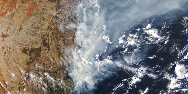 This Nov. 11, 2019, satellite photo taken by NASA shows the weather condition as bushfires burned in the eastern part of New South Wales state.