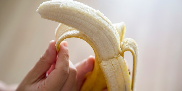 """One Reddit user shared a story about his sister's bizarre method of eating a banana """"like a corn on the cob."""""""