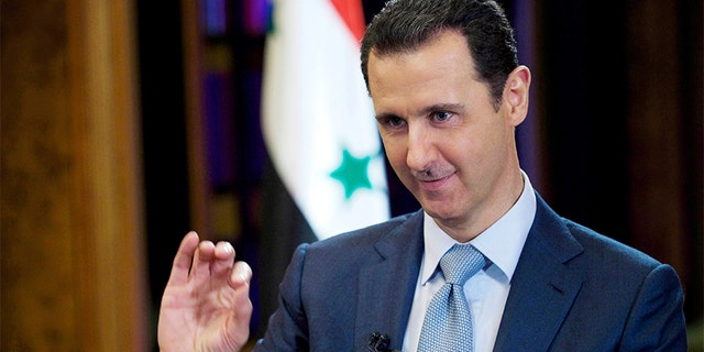 Syrian President Bashar Assad gestures during an interview in Damascus, Syria, in 2015.