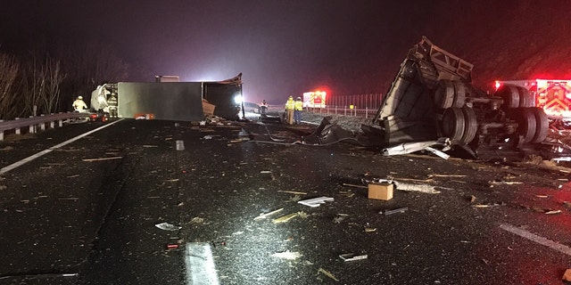 Damage to tractor-trailer can be seen after a multiple-vehicle crash on Interstate 64 in Virginia on Sunday.