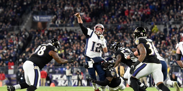New England Patriots quarterback Tom Brady (12) attempts a pass as Baltimore Ravens linebacker Matthew Judon (99) makes a hit during the first half of an NFL football game, Sunday, Nov. 3, 2019, in Baltimore. The pass was incomplete.