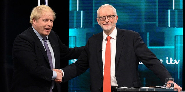 Johnson and Corbyn, shake hands during their election head-to-head debate. (AP)