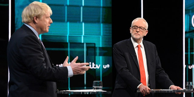 In this photo issued by ITV, Jeremy Corbyn, right, and Boris Johnson, during the election head-to-head debate live on TV, in Salford, Manchester, England, on Tuesday. (AP/ITV)