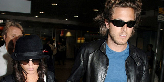 Actress Lindsay Lohan, left, and Harry Morton at London's Heathrow Airport in 2006. (AP Photo, File)