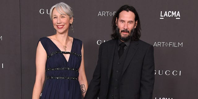 Alexandra Grant and Keanu Reeves arrives at the LACMA Art + Film Gala Presented By Gucci on Nov. 2, 2019 in Los Angeles, Calif.
