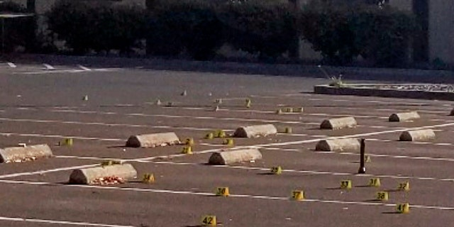 Crime scene evidence markers were placed in the parking lot of the Searles Elementary School where two boys were fatally shot early Saturday morning. (Union City Police Department via AP)