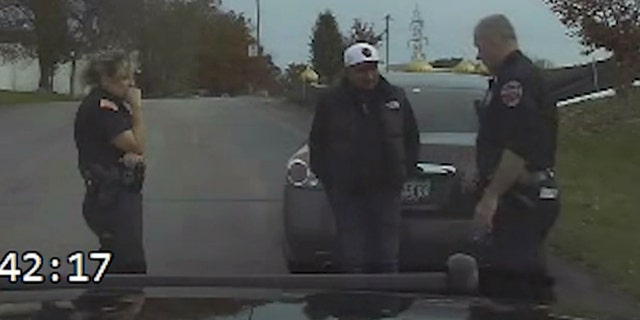 Dashcam footage shows Police administering a field sobriety test on the suspect