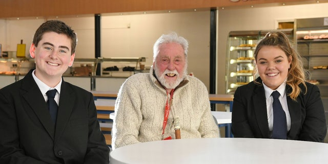 Cyril Aggett, pictured with students Harry Aldridge and Olivia Parsons, enjoys weekly lunches with students and staff at the school near his home.