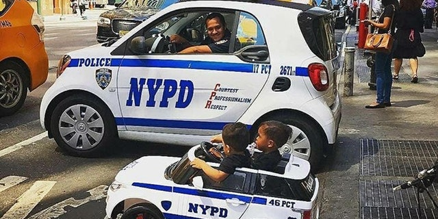 Westlake Legal Group cop-kids2 Toddler 'NYPD lieutenant' twins travel the country to honor police officers Krystina Alarcon fox-news/us/personal-freedoms/proud-american fox-news/us/crime/police-and-law-enforcement fox-news/good-news fox news fnc/us fnc article 592f9613-f42c-5565-98b5-3a98f124e54d