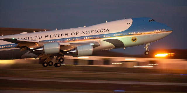 Air Force One leaving Andrews Air Force Base, Md., on Thursday for the campaign trip to Louisiana. (AP Photo/Kevin Wolf)