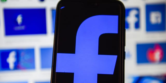 A Facebook logo is displayed on a smartphone. (Omar Marques/SOPA Images/LightRocket via Getty Images)