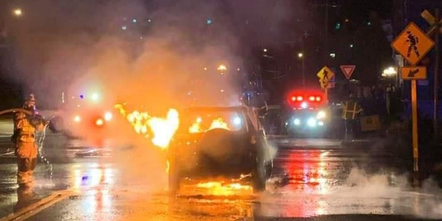 The aftermath of a car fire in Stafford, Conn., where a driver pulled over to pull a man out of the burning vehicle.