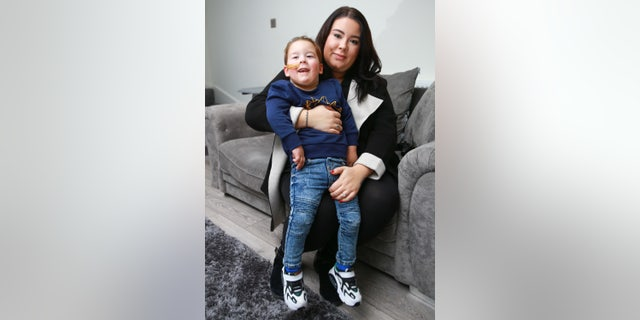 Bleu, pictured with his mother, was never expected to walk after his diagnosis.