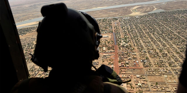 In this 2017 file photo, a French soldier stands inside a military helicopter during a visit by French President Emmanuel Macron to the troops of Operation Barkhane, France's largest overseas military operation, in Gao, northern Mali. (AP)