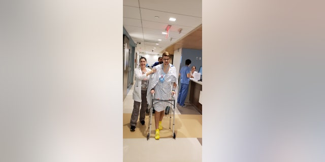 Phelps walking for the first time following sudden cardiac arrest.