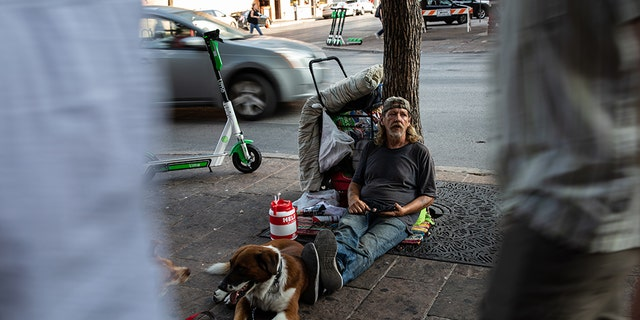 David Fields, who is homeless, sits on Sixth Street in Austin, Texas, on August 14, 2019.