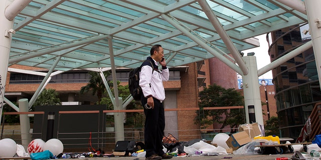 Professor Alex Wai, Vice President of Hong Kong Polytechnic University, takes in the vandalized campus as he leads a team of school officials and first aid providers to look for holed up protesters on a rooftop.