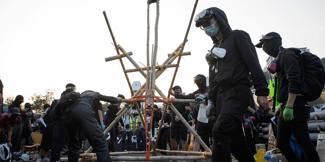Protesters tested a self-made catapult on the barricaded bridge which leads into the Chinese University of Hong Kong on Wednesday. (AP Photo/Ng Han Guan)