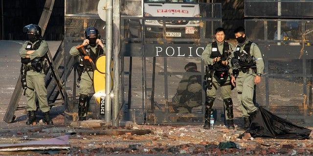 Police cordons off the Hong Kong Polytechnic University campus in Hong Kong on Tuesday, Nov. 19, 2019. (AP Photo/Ng Han Guan)