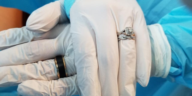 The couple had to wear gloves and surgical gowns at the ceremony.