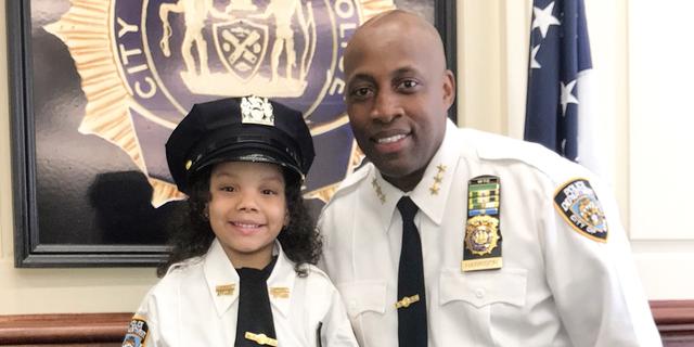 Ferni Balbuena at the 52nd precinct with Chief of Patrol Rodney Harrison