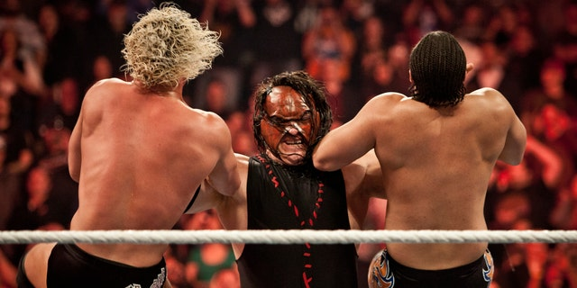 Kane, taking two top stars down during the WWE Raw event at Rose Garden arena in Portland, Ore., Monday February 27th, 2012. (Photo by Chris Ryan/Corbis via Getty Images)