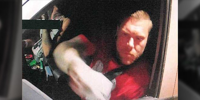 Investigators said this photo showed Anthony Curtis Williams in the stolen pickup of a New Hampshire couple whose bodies were found in a shallow grave on a Texas beach last week. The photo was shot at the Texas-Mexico border.