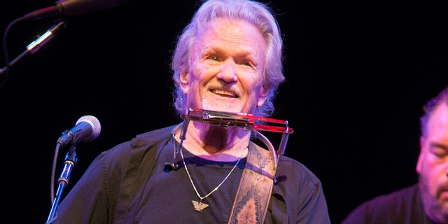 In this April 12, 2019, file photo, Kris Kristofferson performs in concert at The American Music Theater in Lancaster, Pa.  Kristofferson surprised customers when he performed an acoustic guitar at a bar in North Dakota after a band taped a request to the singer - the songwriter's tour bus.
