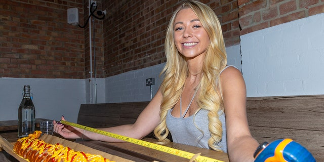 """Kate Ovens — who boasts 170,000 followers on Facebook, nearly 60,000 on YouTube and another 84,000 on Instagram — was offered the challenge after the Oh My Dog! eatery in southeast London created the hot dog, dubbed the """"BFD,"""" specifically for her."""