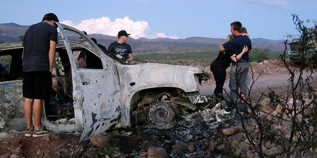 Relatives of slain members of Mexican-American families belonging to Mormon communities observe the burnt wreckage of a vehicle where some of their relatives died, in Bavispe, Sonora state, Mexico in November. A police chief has been arrested for suspected links to the killings, authorities said this week. REUTERS/Jose Luis Gonzalez