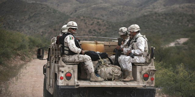 Mexican national guardsmen patrol near Bavispe, at the Sonora-Chihuahua border, Mexico, Wednesday, Nov. 6, 2019.